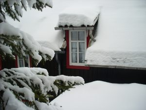Skotta snö från taket